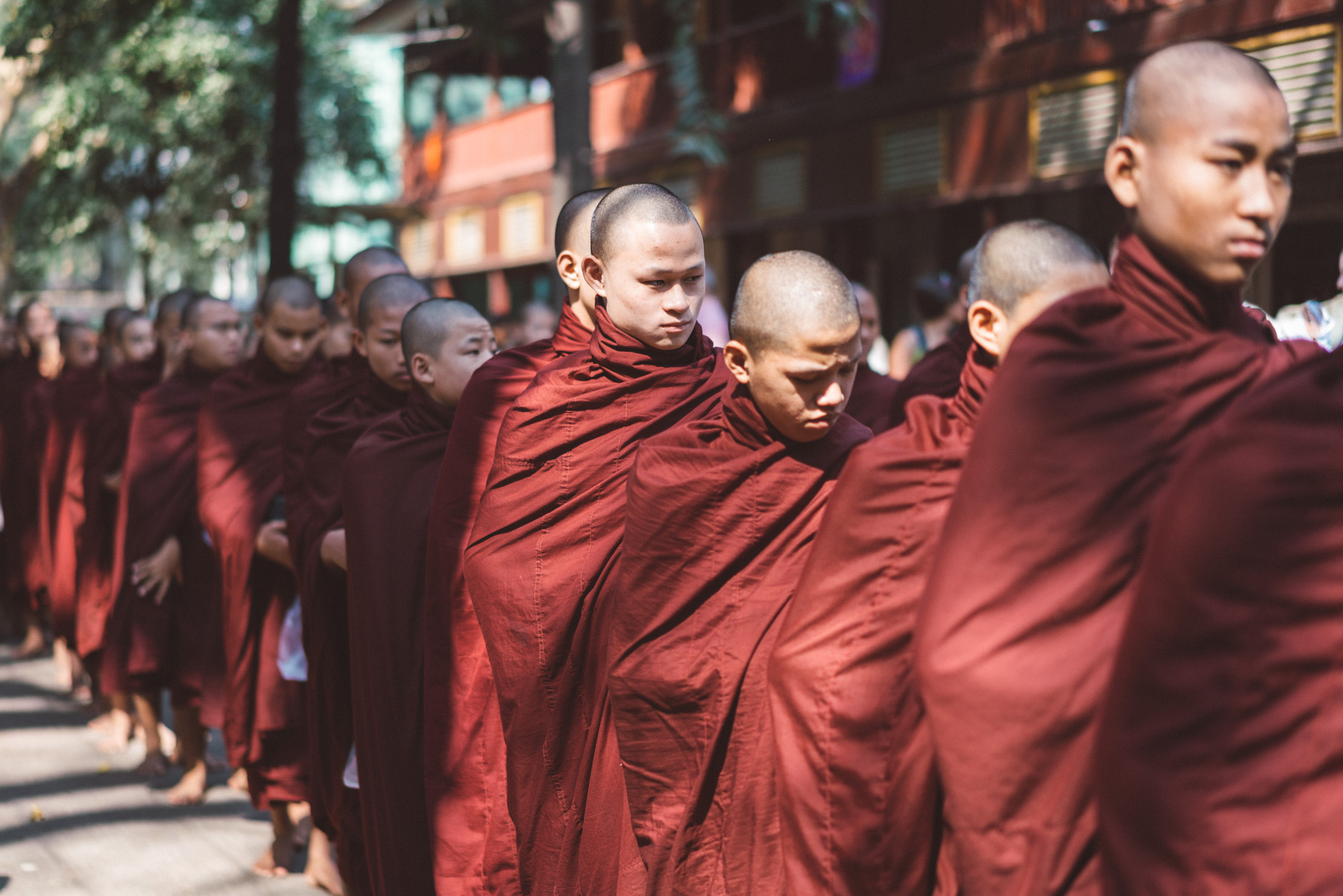 monks queue for lunch [David Tan]